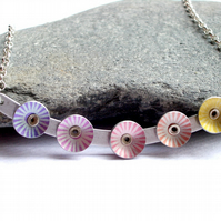 Bar necklace with rivetted coloured starburst circles