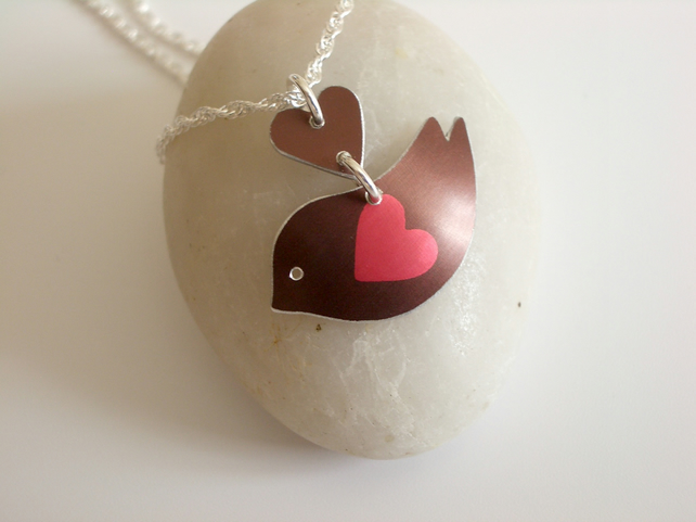 Bird pendant necklace in brown with red heart wing