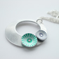 Circle pendant necklace in silver aluminium with purple and green discs