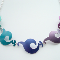 Spiral shapes necklace in purples blues and pinks