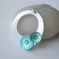 Circle pendant necklace in brushed aluminium with green and blue discs