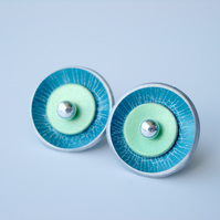 Circle studs in teal and green