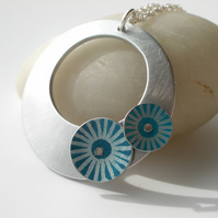 Circle pendant necklace in brushed aluminium with teal and turquoise discs