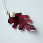 Oak leaf with acorn pearl in plum and red