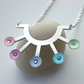 Sunburst necklace with riveted rainbow circles