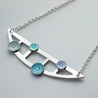 Semi-circle pendant necklace with rivetted circles