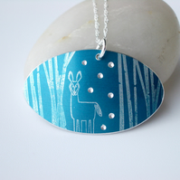 Deer in woods oval pendant in teal