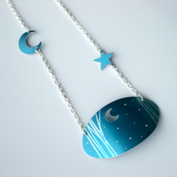 Moon and stars with trees oval necklace