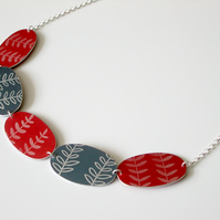 Leaf necklace in red and grey