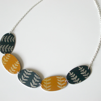 Leaf necklace in orange yellow and grey
