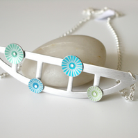 Semi-circle bib necklace with rivetted circles in green and blue