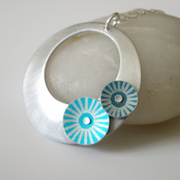 Circle pendant in brushed aluminium with turquoise and teal discs