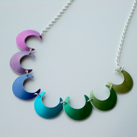 Crescent necklace in a spectrum of colours