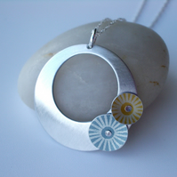Circle pendant necklace in brushed aluminium with grey and yellow discs