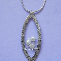 Silver oval drop pendent
