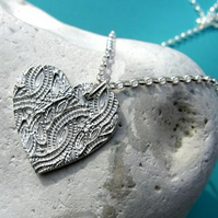 Fine silver heart necklace with surface imprint