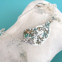 Fine silver bird necklace with copper verdigris patina