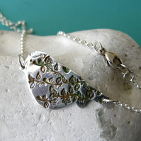 Fine silver bird necklace with leafy pattern