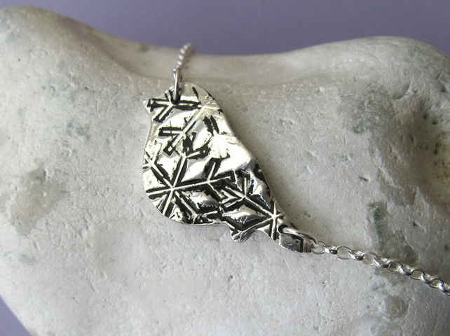 Fine silver necklace with black snowflake pattern