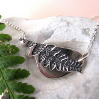 Fine silver bird necklace with fern leaf imprint