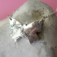 Fine silver butterfly necklace with dandelion clock pattern