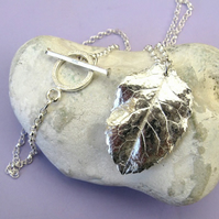 Fine silver rose leaf necklace with fancy toggle bar