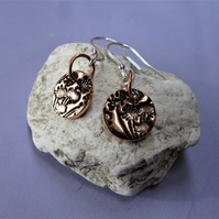 Sterling silver and copper earrings with floral pattern