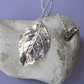 Fine silver rose leaf necklace