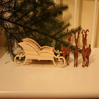 Elegant Wooden Reindeer and Sleigh