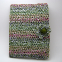 Green and pink crochet book cover