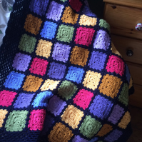 Rainbow Granny Square Crocheted Blanket