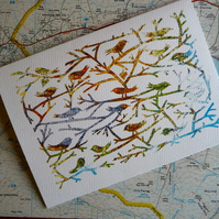 Birds Of A Feather, papercut on vintage map