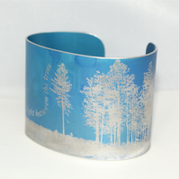 Light between the trees poetry cuff