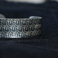 Geometric squirrel print cuff bracelet black