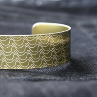 Golden bird print aluminium cuff