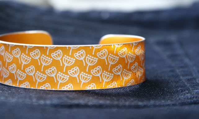 Geometric seed head print cuff bracelet orange