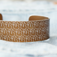 Anodised aluminium squirrel print cuff bronze