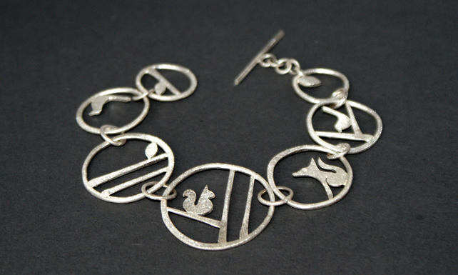 Edge of the woods silver statement bracelet - squirrel, fox, bird