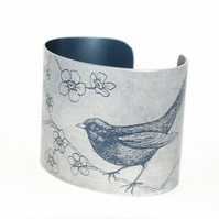 Blackbird and blossom cuff