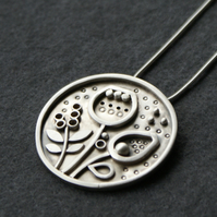 Seeds and pods statement silver pendant
