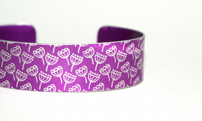 Pink aluminium cuff with seed head pattern