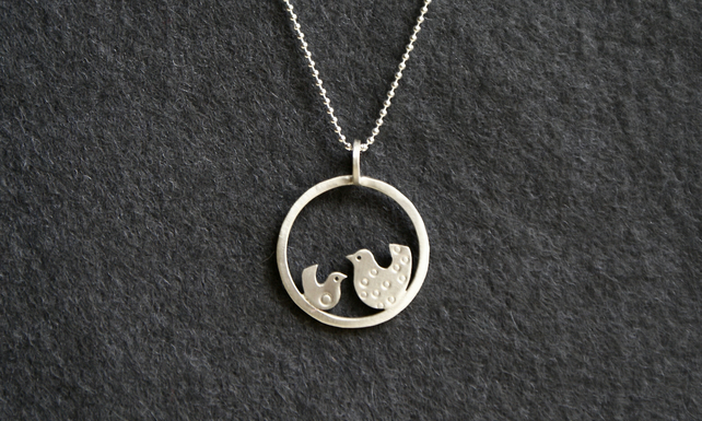 Silver chickenish necklace