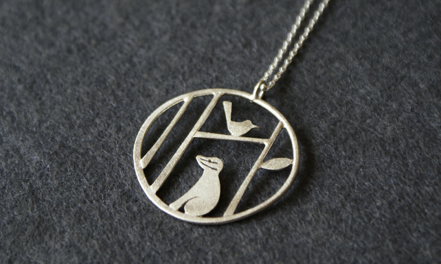 Edge of the woods badger and bird necklace