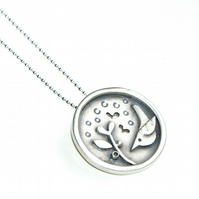 Bird and seedling silver pendant