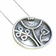Silver sunflower pendant