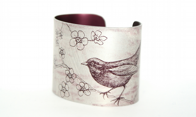 Blackbird and blossom anodised aluminium cuff - dark red