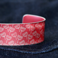 Geometric seed head print cuff bracelet red