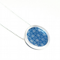 Silver and blue circle necklace - flower pattern