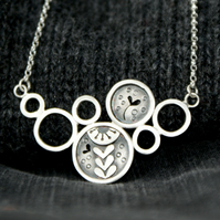 Silver seed head circles bib necklace