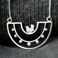 Silver bird bib necklace